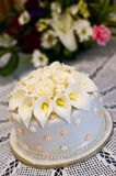 Wedding cake with white orchid flowers. With white doily Stock Photo