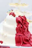 Wedding cake in white and wine red with flowers Stock Photography
