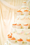 Wedding cake whith cupcakes Royalty Free Stock Photo