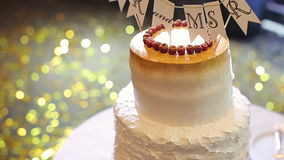 Wedding cake with the words Mr. and Mrs. Wedding desert stock video