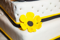 Wedding cake with yellow flowers Stock Photos