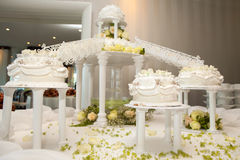 Wedding cakes with roses connected by bridges Royalty Free Stock Photo