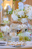 Wedding cakes on a table with flowers. Wedding cakes on a table with white flowers royalty free stock photo