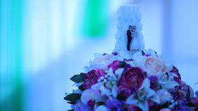 Wedding candle in flowers. Candle with figures. stock footage