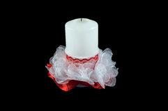 Wedding candle on an isolated background. Wedding candle symbolizing hearth and home Royalty Free Stock Image