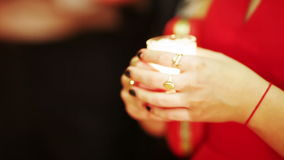 Wedding candles in hands stock video