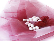 Wedding candy. Small wedding candy with almonds inside on color tulle royalty free stock photos