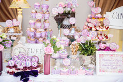Wedding Candy bar. Candy bar with biscuits, fruits, macarons and cupcakes Stock Image