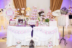 Wedding Candy bar. Candy bar with biscuits, fruits, macarons and cupcakes Stock Images