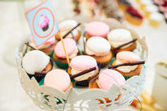 Wedding Candy bar. Candy bar with biscuits, fruits, macarons and cupcakes Stock Photo