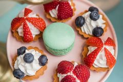 makaroons with berries cakes royalty free stock photography