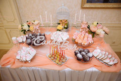 Wedding candy bar, table with sweets decoration setup with delicious cakes and dessert.  Royalty Free Stock Photos