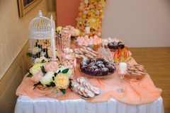 Wedding candy bar, table with sweets decoration setup with delicious cakes and dessert.  Stock Image