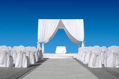 Wedding canopy with chairs. All in white on blue sky Royalty Free Stock Images