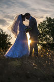 Wedding. At Cape Fiolent The bride and groom in the light of kantrovom Royalty Free Stock Images