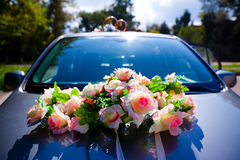 Wedding car. Car with wedding bouquet and rings Stock Photography