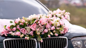 Wedding car. Decorated with bunch of flowers Stock Photography