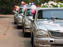 Wedding car. Married bride wedding flower bouquet limousine car Stock Images