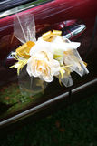 Wedding car. Red wedding car with roses bouquet tied on the door handle Royalty Free Stock Image
