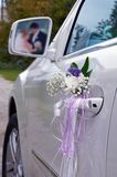 Wedding car. The wedding car with registration and reflection of a newly-married couple in a rear-view mirror Royalty Free Stock Images