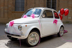 Wedding car. Little wedding car, vintage vehicle for just-married Royalty Free Stock Image