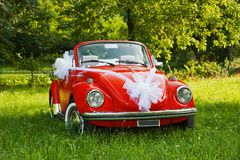 Wedding car. Red wedding car with white ribbon Royalty Free Stock Photo