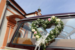 Wedding Car. Vintage car decorated with wedding flowers Stock Image