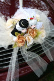 Wedding car with bear. Red wedding car with bridal bear and roses bouquet Royalty Free Stock Image