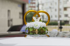 Wedding car with beautiful decorations in white and blue. Wedding car with beautiful decorations in the form of rings Royalty Free Stock Photos