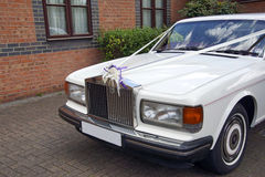 Wedding car. A beautiful Rolls Royce car with wedding ribons stock photography