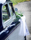 Wedding car with bouquet Stock Image