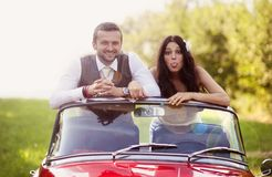 Wedding car with bride and groom Royalty Free Stock Photo