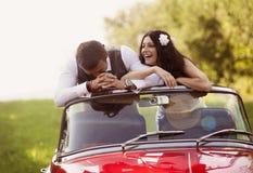 Wedding car with bride and groom Stock Photos