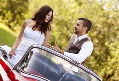 Wedding car with bride and groom Royalty Free Stock Image