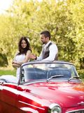 Wedding car with bride and groom Stock Images