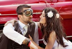 Wedding car with bride and groom Stock Photo
