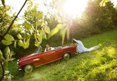 Wedding car with bride and groom Stock Photography