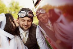 Wedding car with bride and groom Royalty Free Stock Photos