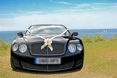 Wedding car by coast Stock Photos