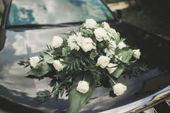 Wedding car decorated with beautiful, luxury flowers.  stock photos