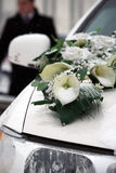 Wedding car decorated with flowers. White wedding car decorated with flowers Stock Photo