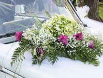 Wedding car decorated with flowers stock photos