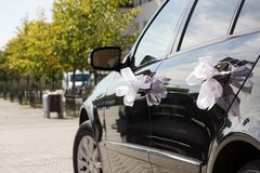 Wedding car decorated by ribbons Royalty Free Stock Photo
