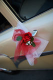 Wedding car decorated with a rose flower. Wedding car decorated with a red rose flower Stock Image