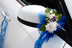 Wedding car decoration. With flowers and ribbons Royalty Free Stock Images