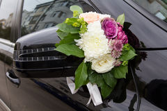 Wedding car decoration. With flowers and ribbons Royalty Free Stock Photo