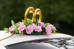 Wedding car decoration. Wedding car decorated with rings, bells and flowers Stock Photo