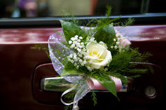 Wedding car decoration. Wedding flowers on the car Royalty Free Stock Photos