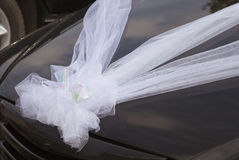 Wedding car decoration. Bow of white ribbons Royalty Free Stock Images