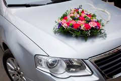 Wedding car decoration with flowers Stock Photos